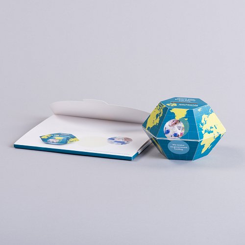 Pop up ball with unglued wallet